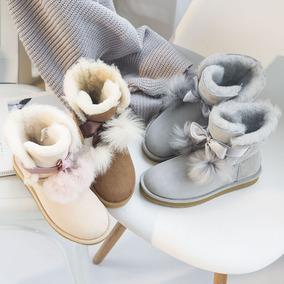 2017新款毛球羊皮毛一体雪地靴女冬季中筒baby同款保暖防水棉短靴