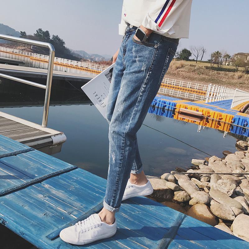 男韩版休闲潮流弹力牛仔裤青少年小脚修身破洞裤子